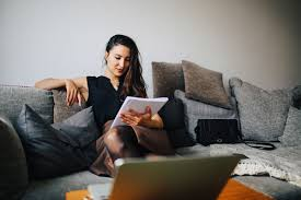 apply now work from home jobs for writers and editors young w reading at home