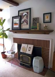 image above olivia san mateo s fireplace if you don t have a real mantle just use a shelf to create one above the fireplace like olivia