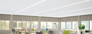large format acoustical panels are downward accessible for minimal plenum heights