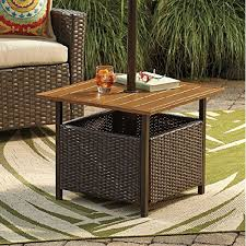 high top patio table outdoor patio bar table table chair cushions carpet glasses books