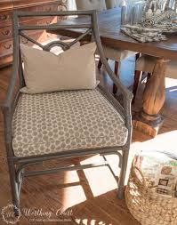 rattan chair after i painted them with rustoleum spray paint in anodized bronze for me it s the perfect gray with brown undertones which warms the color