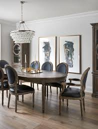oval french dining table with black leather round back chairs