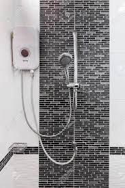 Shower And Water Heater On Wall In Bathroom Stock Photo Picture And Royalty Free Image Image 61133482