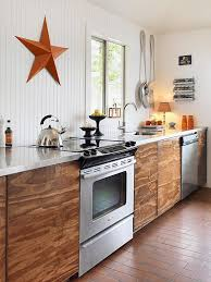 vancouver beadboard walls in kitchen beach style with orange contemporary dishwashers giant spoon
