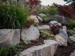 boulder retaining wall wood traditional landscape
