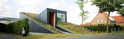 a sloping green roof hides the split level interior of belgium s discrete house pibo
