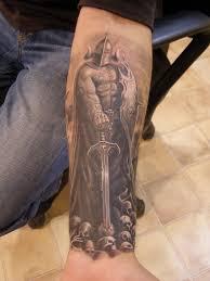 фото тату варвар с черепами на мече татуировки и эскизы воины