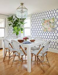 blue and white dining room parsons table beaded chandelier wallpaper bistro chairs