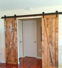 interior beauty textured wood rustic sliding barn door decor with red painted wall also textured
