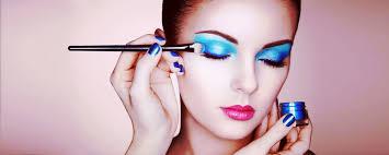 a makeup artist applying blue eyeshadow