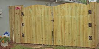 wood fence double gate. Board On Wood Fence With Arched Double Drive Gate E