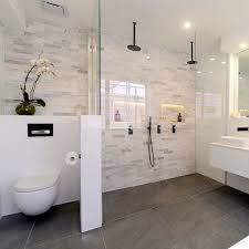 I like the clear doors and how the flooring is the same throughout the  bathroom.