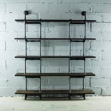 black steel industrial pipe wall mounted 5 shelf bookcase with reclaimed aged wood