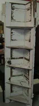 lovely idea reusing an old door for shelving i am not sure where this picture