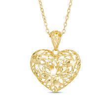 diamond cut fl puffed heart pendant in 10k gold 17