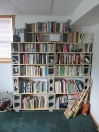 concrete block furniture ideas. Tall DIY Cinder Block Bookcase With Six Tiered Wooden Shelves From Dark Grey Floor To White Ceiling Cool Interior Idea Concrete Furniture Ideas