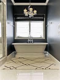 master bathroom with marble style vinyl tile floor and pedestal tub