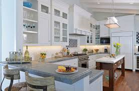 traditional u shaped kitchen with small island with carrara marble countertop