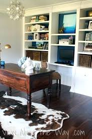 on using a real or faux cowhide rug in home office area rugs for placement