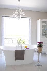 Bathrooms:Modern Bathroom With Large Bathtub And Unique Modern Side Table  Near Modern Sink White