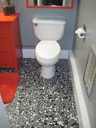 Vintage pebble floor tile launches Texs gray black orange and