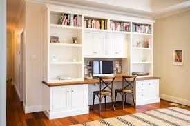 desk with bookshelves above home office traditional with double desk striped rug book shelves