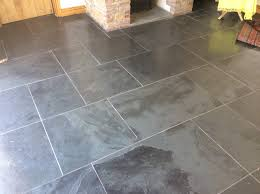 keen to use sympathetic s for this painstaking barn conversion our client decided on chunky slabs of natural black slate laid in multi sizes inside