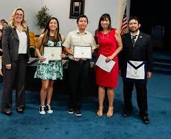 abbie stirone congratulate students chuong tran and emily lopez on receiving a special student recognition from the garden grove masons ggusd photo
