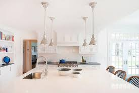 large kitchen island with four mini industrial pendants