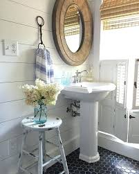 small bathroom with shiplap walls walls and black tile in this small farmhouse bathroom small bathroom