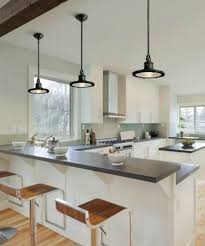 lighting above kitchen island. series of modern black pendant lighting over kitchen island above a