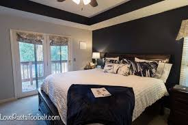 find some inspiration for a navy and gray master bedroom for a luxurious and cozy room