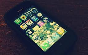 Black Microsoft Nokia Phone with iPhone ...