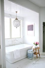 chandelier above tub 6 simple stylish interiors were gaga over best friends for frosting chandelier tub