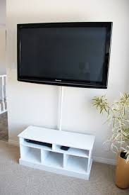 remodelaholic 95 ways to hide or decorate around the tv hide television wires shower rod cover fresh crush