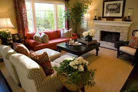 pictures of beautifully decorated living rooms. bright red punctuates this room lit by large windows, featuring dark wood floor with tan pictures of beautifully decorated living rooms
