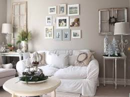 large wall decor ideas for living room with white fabric chair covers and small round table also wall photo frame ideas