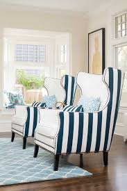 dotolo completely customized two bernhardt wingback chairs in a striped fabric from kravet on the back and a durable vinyl from majilite on the front