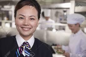 Restaurant Hostess Restaurant Hostess In An Industrial Kitchen