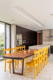 tuscan leather belvedere dining armchair the custom kitchen counters are concrete and the yellow dining chairs