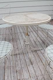 the first step to transforming this patio set was to clean away as much dirt rust and flaking paint as possible i used steel wool