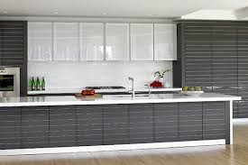 View in gallery Sleek modern kitchen in black with gorgeous glass cabinets  all around