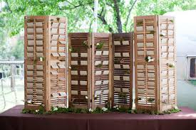 cute diy ideas for escort card placement wedding tips and trends Rustic Wedding Place Card Ideas simply place your cards over each slat rustic wedding place card holders