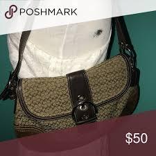 Coach Monogram Handbag in Brown Canvas and leather construction. Medium  brown Coach monogram shoulder bag