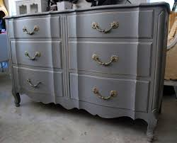 Gray Painted Bedroom Dresser With Six Drawer Storage And Golden Metal  Handles Also Protruding Surface On Claw Foot Base