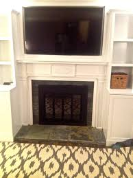 reface brick fireplace spaces traditional with accent lights above