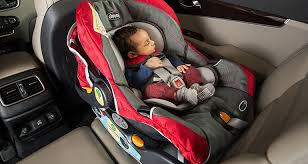 baby on a car seat