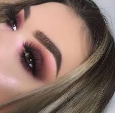 brown smokey eyes with a touch of plum look fabulous on brown eyes