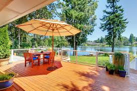 deck ideas. Wood Deck With Beautiful Lake View And Outdoor Patio Furniture Umbrella Ideas