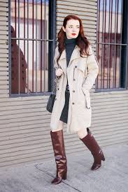 patent boots with knitted dress and trench coat